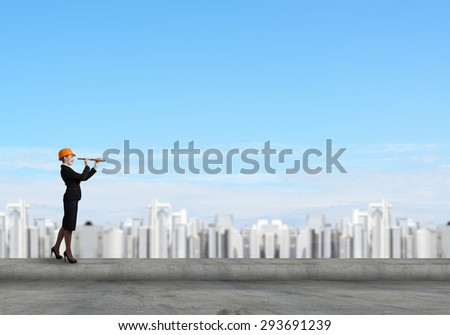 Attractive woman engineer in hardhat looking in spy glass - stock photo