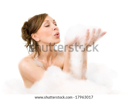 Attractive woman enjoys  in the bathtub - stock photo