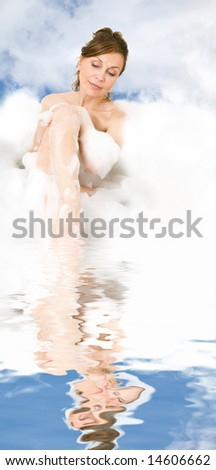 Attractive woman enjoys the bath-foam in the bathtub. - stock photo