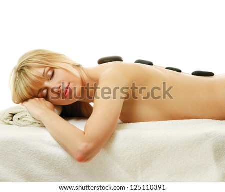 Attractive woman getting spa treatment isolated on white background - stock photo