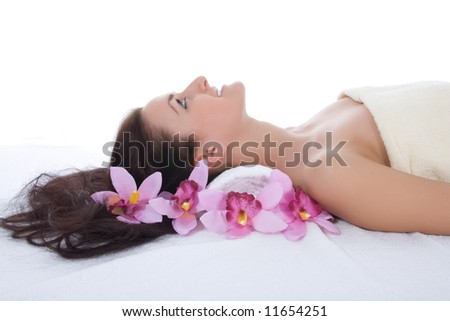 Attractive woman getting spa treatment on white