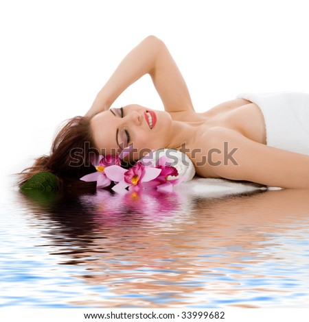 Attractive woman getting spa treatment on white - stock photo
