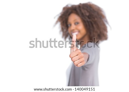 Attractive woman giving her thumb up on white background