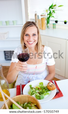 Attractive woman having an healthy dinner at home - stock photo