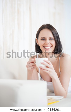 Attractive woman having coffee at home