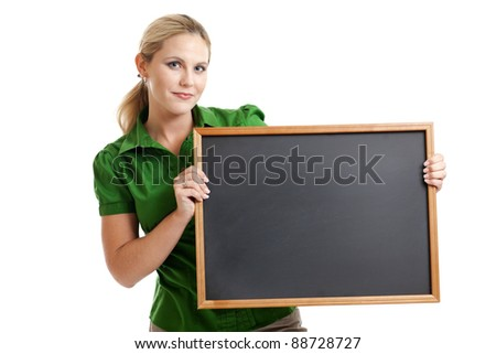Attractive woman holding a blank chalkboard isolated on a white background - stock photo