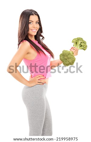 Attractive woman holding a broccoli dumbbell isolated on white background - stock photo