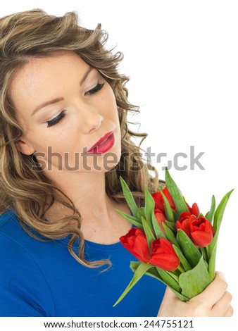 Attractive Woman Holding a Bunch of Tulips