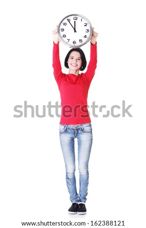 Attractive woman holding a clock above her. Isolated on white.  - stock photo