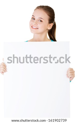 Attractive woman holding a poster with copy space. Isolated on white.