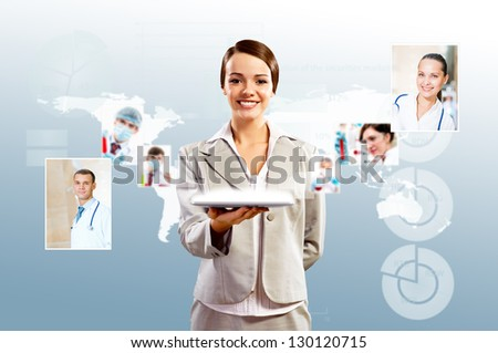 attractive woman holding a tablet pc and smiling, concept of social networks, collage - stock photo