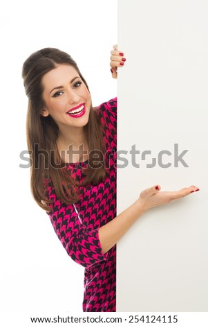 Attractive woman holding blank poster  - stock photo
