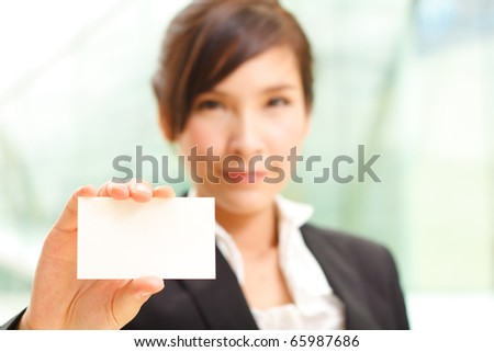 Attractive woman holding business card