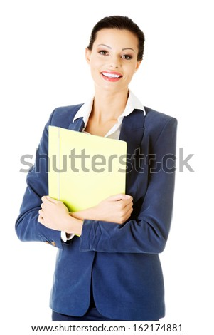 Attractive woman holding files. Isolated on white.  - stock photo