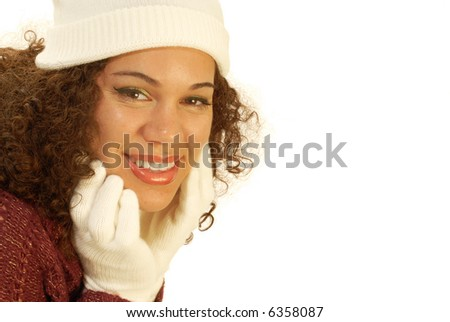 Attractive woman holding her face and smiling; winter banner ready for copy space - stock photo