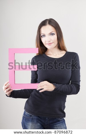 Attractive woman holding letter E. Sale concept.