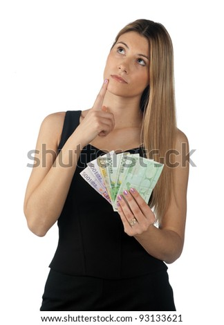 attractive woman holding money in her hands - stock photo