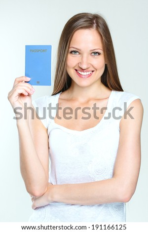 attractive woman holding passport. - stock photo