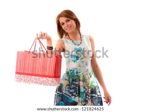 attractive woman holding shopping bags against a white background - stock photo