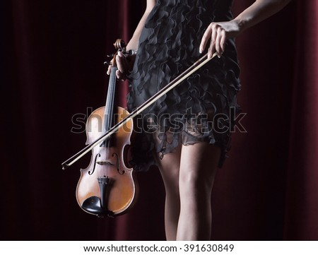 Attractive woman holding violin