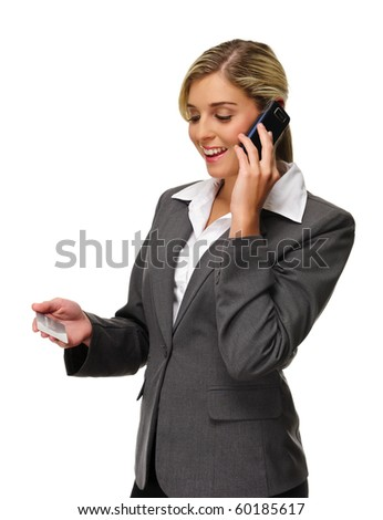 Attractive woman holds credit card and talks on phone
