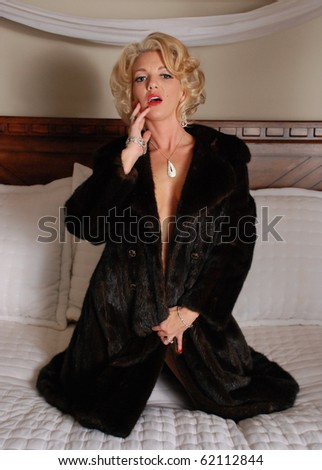 Attractive Woman in a Fur Coat and Jewelry - stock photo