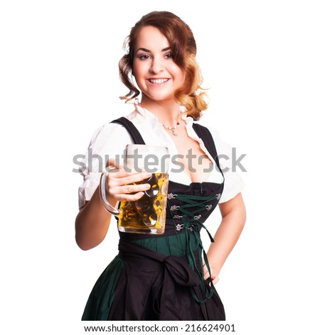 attractive woman in a traditional dirndl with a beer - stock photo