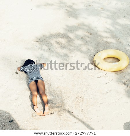 attractive woman in bikini, outdoor shot in sand, summer day - stock photo
