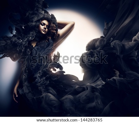 attractive woman in black smoke - stock photo