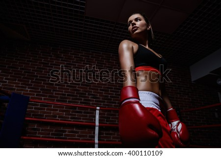 Attractive woman in boxing ring