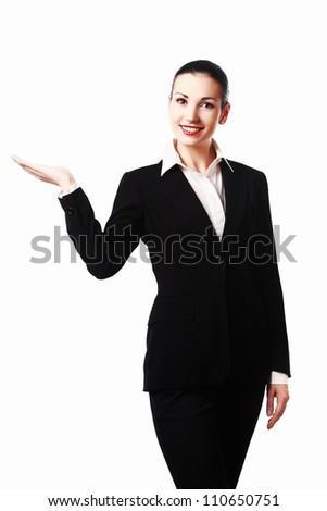 Attractive woman in business suit presenting something with her hand or holding something. Isolated on white background - stock photo