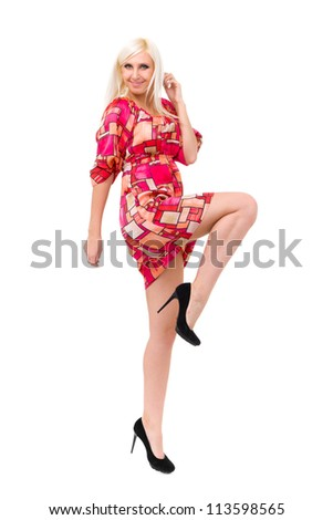 Attractive woman in dress dancing on a white background