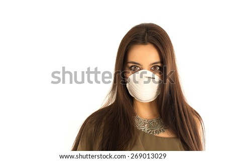 Attractive woman in elegant dress wearing a protective mask with her long dark hair, closeup portrait of an interesting Asian - Caucasian mixed woman on a white background with space for your text. - stock photo