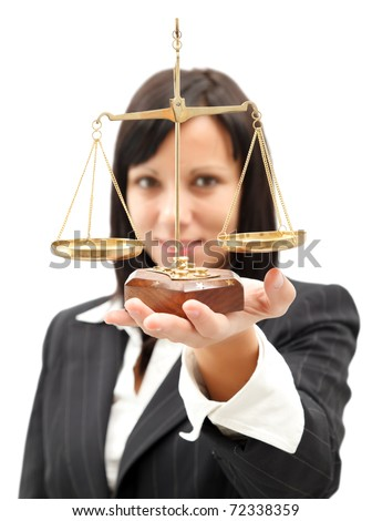Attractive woman in elegant suit holding scales of balance - stock photo