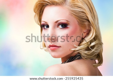 attractive woman in evening wear - stock photo