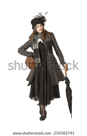 Attractive woman in front of white background - typical Mary Poppins  - stock photo