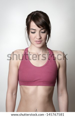 Attractive woman in gym clothes shot in the studio - stock photo