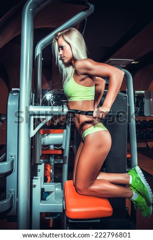 attractive woman in gym on workout machine  - stock photo