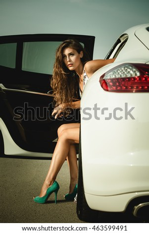 attractive woman in high heel shoes get out the car summer day on the road
