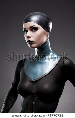 Attractive woman in latex neck corset, studio shot on black background - stock photo
