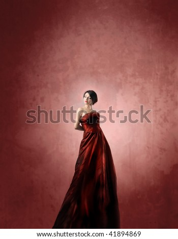 attractive woman in red dress - stock photo