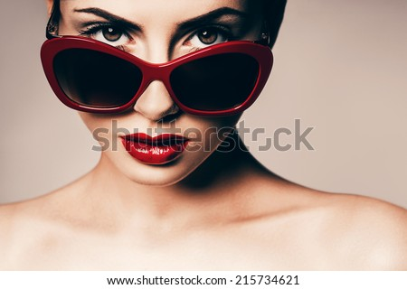 attractive woman in red sunglasses