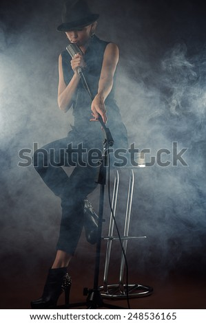 attractive woman in retro style with smoke - stock photo