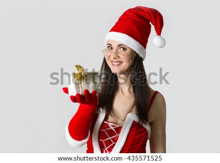Attractive woman in Santa costume with Christmas gifts - stock photo