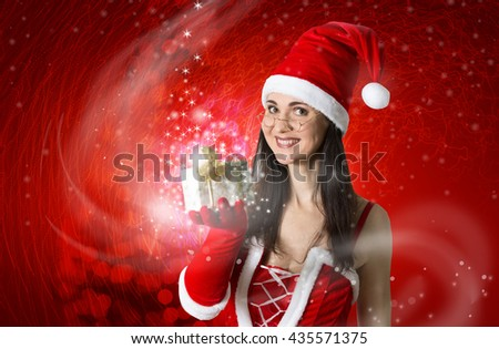 Attractive woman in Santa costume with Christmas gifts. Christmas background