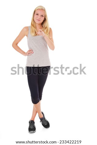 Attractive woman in sports wear. All on white background. - stock photo