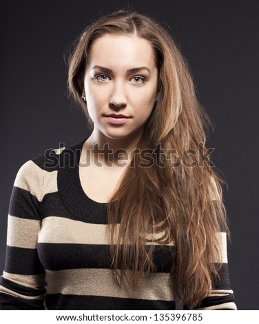 attractive woman in studio - stock photo