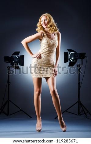 Attractive woman in studio shooting - stock photo