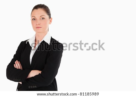 Attractive woman in suit posing while standing against a white background - stock photo
