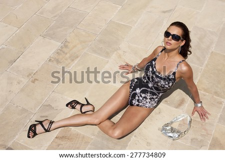 Attractive woman in swimwear, outdoor shot on a summer day - stock photo